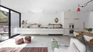"""The kitchen in the new addition of Janus House, designed by Carol Moukheiber and Christos Marcopoulos of Studio NMinusOne for Dutch-born owner Ghislaine Beckers. 'When you build something new, you build something that looks contemporary,"""" Ms. Beckers said."""
