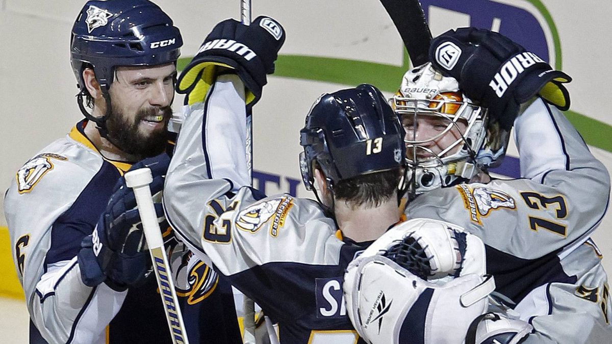 Nashville Predators' Nick Spaling (13), Shea Weber, left, and goalie Pekka Rinne, right, of Finland, celebrate after the Predators beat the Anaheim Ducks. (AP Photo/Mark Humphrey)