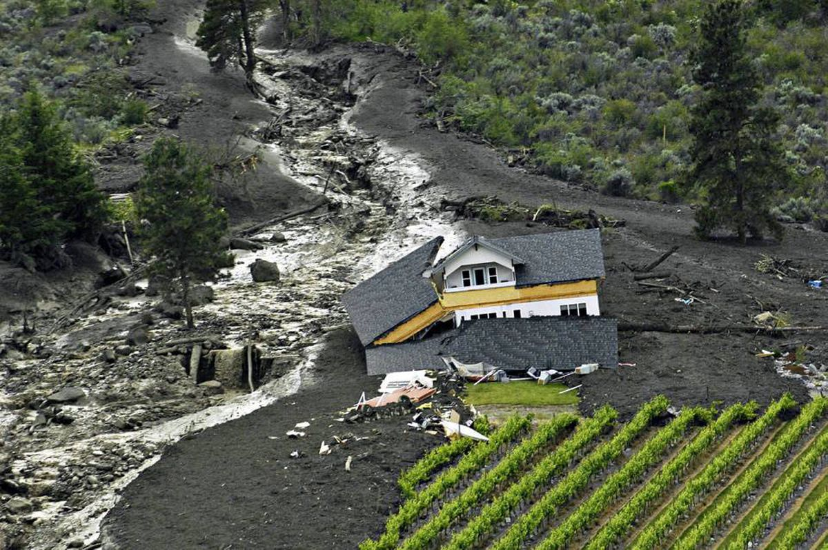 Debris from a landslide is shown from the air near Testalinden Creek, just south of Oliver, B.C. on Sunday June 13, 2010. As rescuers made their way through the debris of a landslide that struck several homes in southern British Columbia on Sunday, it began to appear that most area residents had made it out in time.