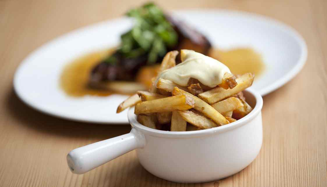 Fries with Aioli at Cafe Belong at Evergreen Brick Works shot with shallow depth of field.