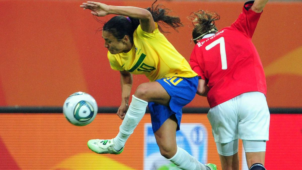 Brazil's striker Marta (L) vies for the ball with Norway's defender Trine Ronning (R) during the Group D football match of the FIFA women's football World Cup Brazil vs Norway in Wolfsburg, central Germany, on July 3, 2011.