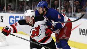 New Jersey Devils' Jacob Josefson, of Sweden, left, and New York Rangers' Michael Del Zotto struggle for position during the first period of Game 5 of an NHL hockey Stanley Cup Eastern Conference final playoff series, Wednesday, May 23, 2012, in New York.
