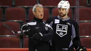 Los Angeles Kings' head coach Darryl Sutter gives instructions to Willie Mitchell during their team practice in Glendale earlier this month.