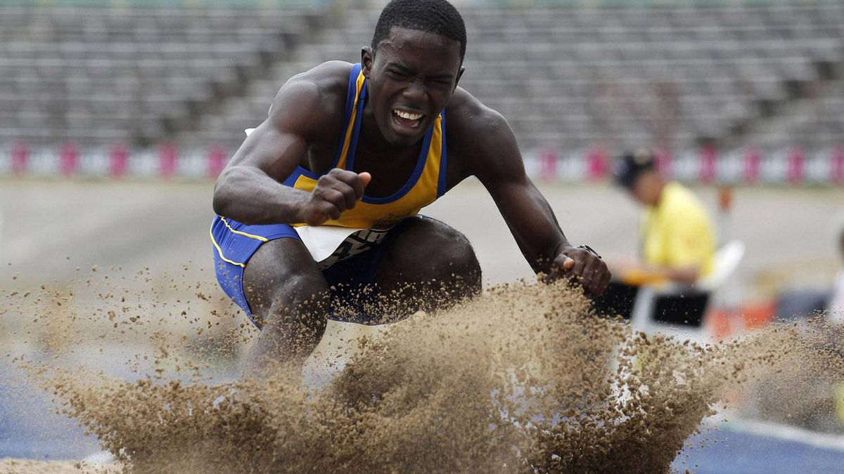 An athlete competes in the boy's long jump at the Jamaica's Inter-Secondary Schools Boys and Girls Athletics Championships in Kingston March 28, 2012. REUTERS/Ivan Alvarado