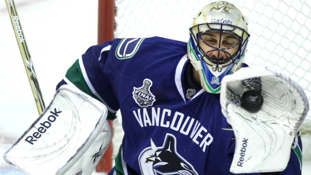 Vancouver Canucks goalie Roberto Luongo makes a save in the first period.