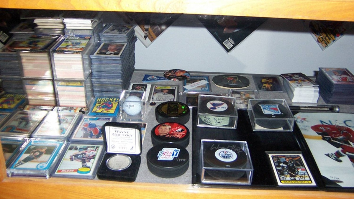 The pile of cards are all about The Great One, from his rooky card to his retirement, as well as autographed pucks