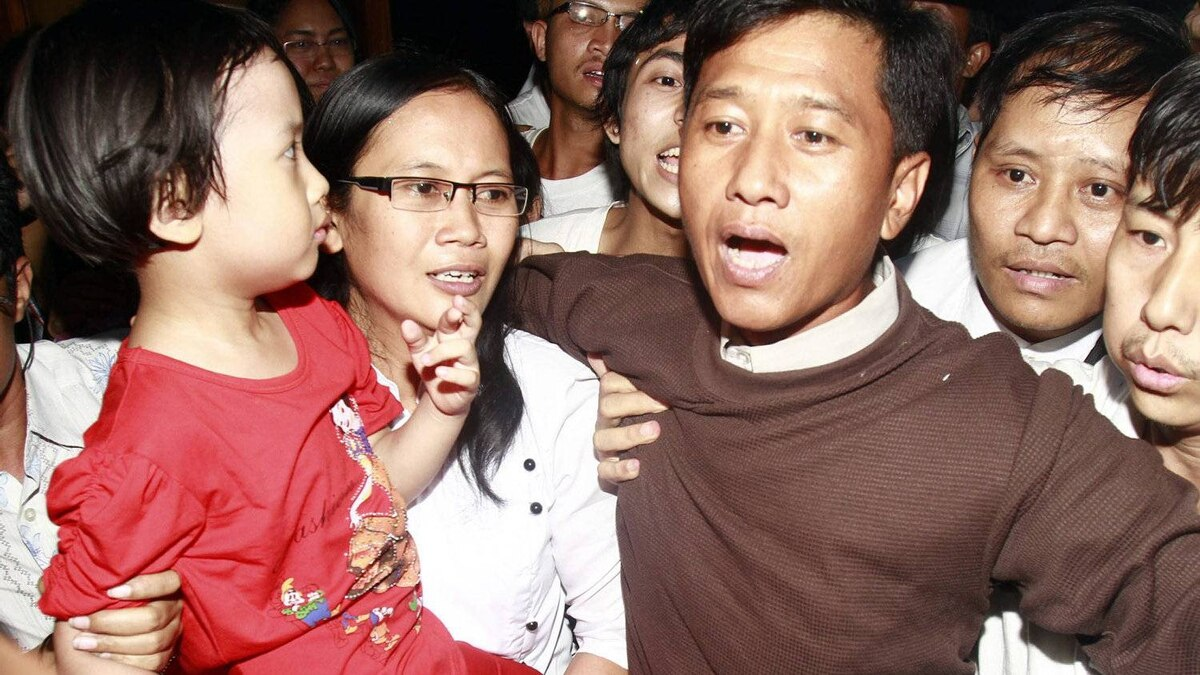 Jim Mee, right, and Nilar Thein, center, activists of the 88 Generation Students Group, gets welcomed by their daughter, left, at Yangon airport after being released from prison Friday, Jan.13, 2012, in Yangon, Myanmar. Myanmar freed many of its prominent political prisoners Friday in a long-awaited step toward national reconciliation that also has been a key condition set by Western nations for easing sanctions against the country.