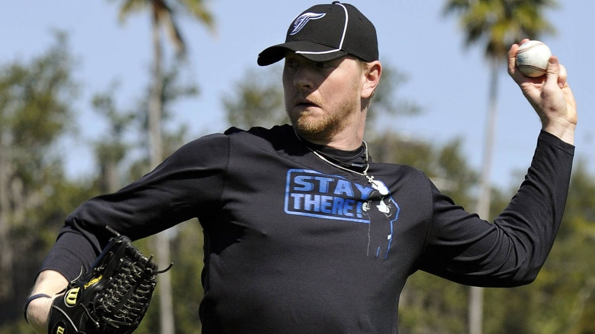 Toronto Blue Jays pitcher David Purcey throws during practice at their MLB American League spring training facility, in Dunedin Florida, February 13, 2011. REUTERS/ Mike Cassese