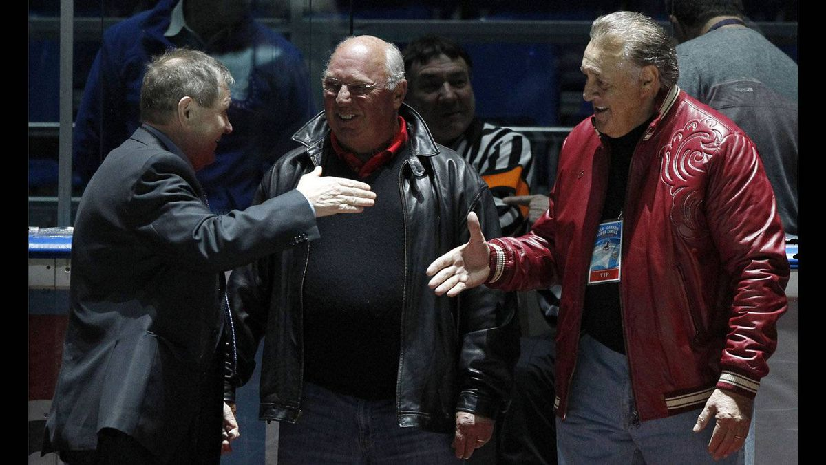 Canadian former hockey players Phil Esposito, right, and Dennis Hull, centre, greet former rival Russian hockey player Alexander Maltsev during the starting ceremony for an exhibition game in Moscow on Feb. 25, 2012 between teams of Russian and world stars to mark the anniversary of U.S.S.R.-Canada 1972 Summit Series.