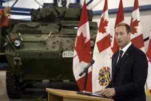 Defence Minister Peter MacKay addresses an audience of military personnel at CFB Gagetown in Oromocto, N.B., on July 8, 2009. MacKay announced that the federal government is spending $5-billion to upgrade the Canadian army's combat vehicles, including the LAV-3s that are now in service in Afghanistan.