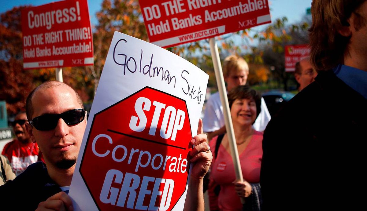 Activists protest outside Goldman Sachs's Washington, D.C., office.