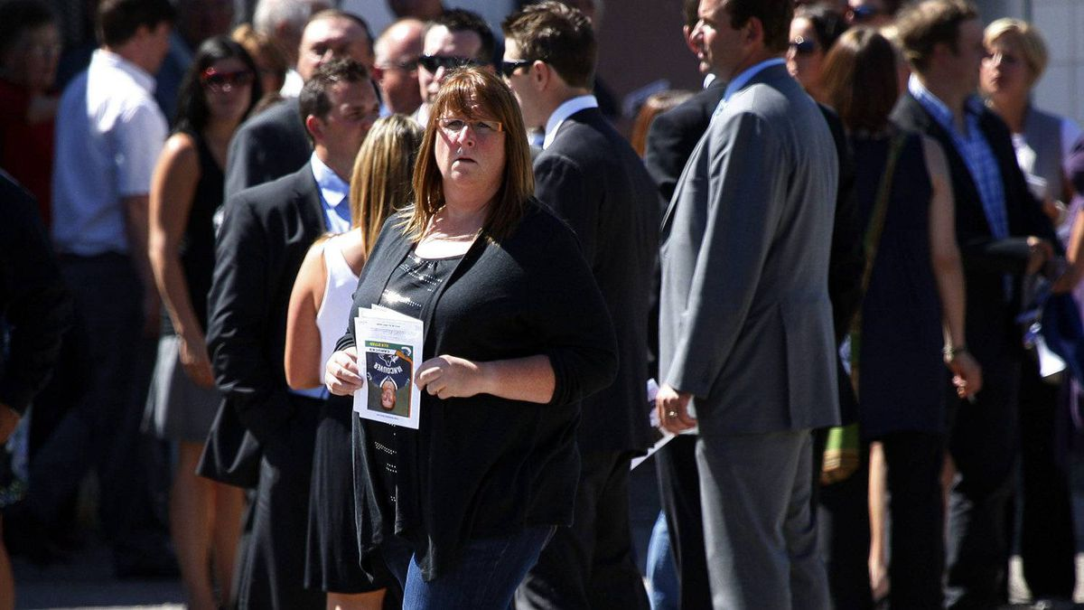 Mourners leave the funeral service for Winnipeg Jets player Rick Rypien. THE CANADIAN PRESS/Jeff McIntosh