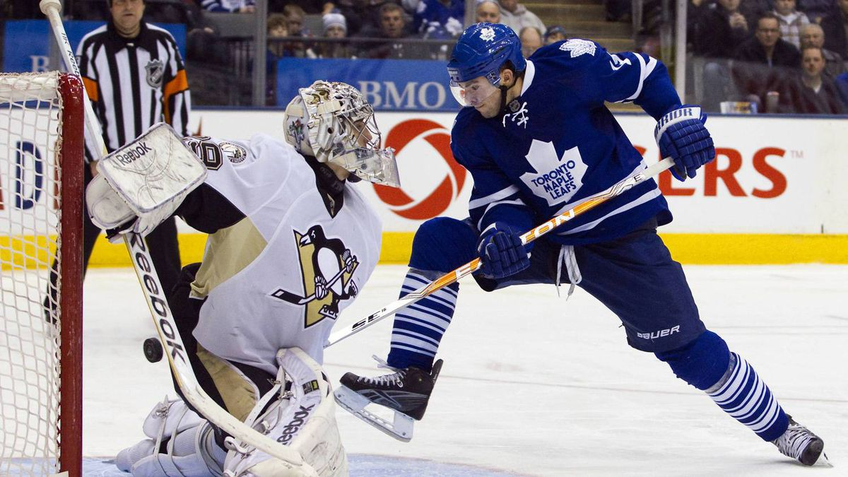 Toronto Maple Leafs Joffrey Lupul appears to score on Pittsburgh Penguins goalie Marc-Andre Fleury but the goal was disallowed after official review in the second period of their NHL hockey game in Toronto February 26, 2011. REUTERS/Fred Thornhill