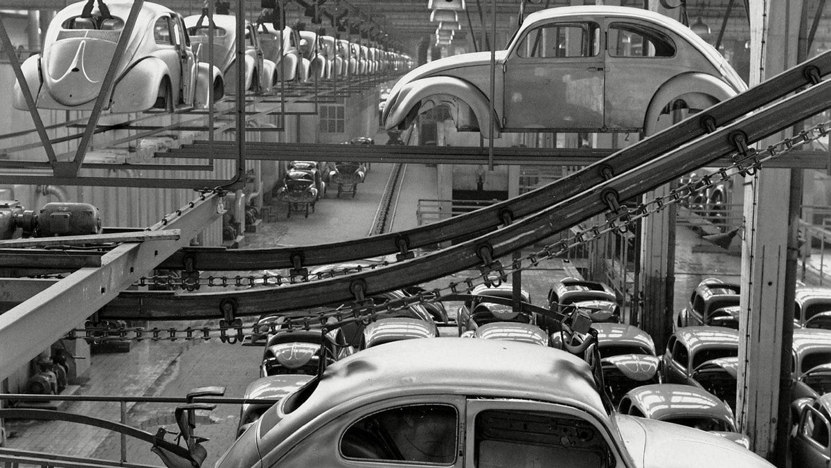A Volkswagen Beetle production line in 1955. Note the oval rear window, which later became a prized feature for VW collectors.