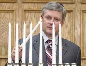 Prime Minister Stephen Harper takes part in a menorah lighting ceremony in Ottawa on Wednesday, Dec. 16, 2009.