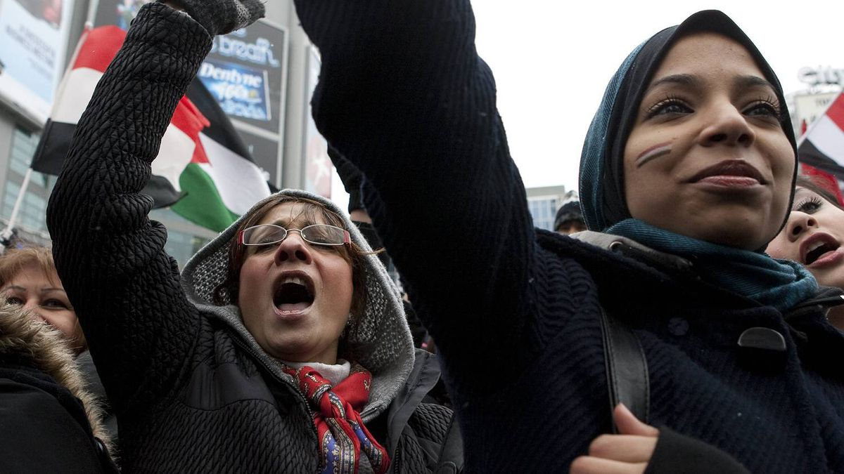 Members of the Egyptian and Arabic communities in Toronto chant slogans as they gather to celebrate the resignation of Egyptian President Hosni Mubarak on Saturday February 12, 2011.