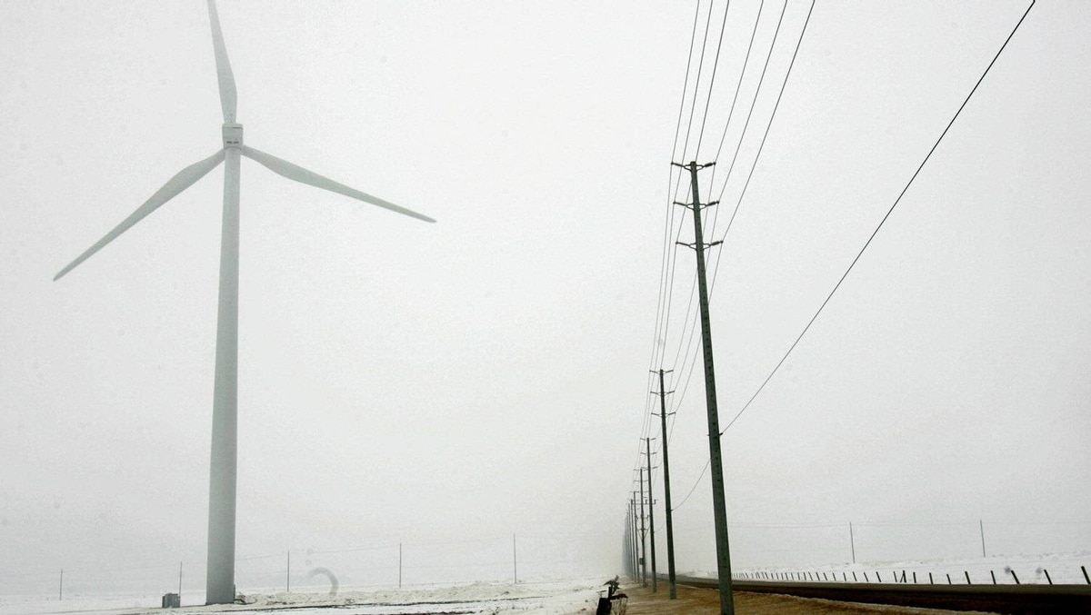 A view of a wind turbine as it spins at wind farm project in Ontario.