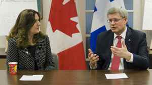 Prime Minister Stephen Harper speaks with Melpa Kamateros, executive director of Shield of Athena in Montreal, Friday, March 16, 2012, prior to announcing support by the Canadian government to address family violence and violence against women.