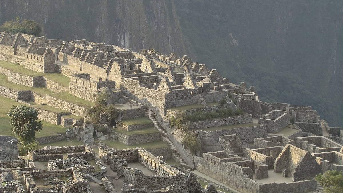 Sharon McMillan photo: Machu Picchu - Architecture the best of construction and design Machu Picchu - 5 PM August 20, 2010 - close-up of Urban Eastern Sector and Industrial District taken from the terraces. Deserted, note construction and design, built 7,000 ft atop a mtn, 500 + yrs ago.