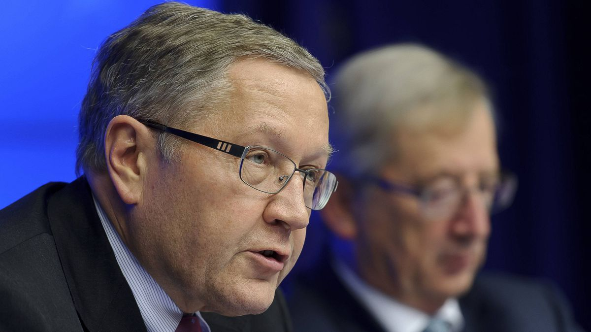 Klaus Regling, chief executive officer of the European Financial Stability Fund, left, speaks as Jean-Claude Juncker, Luxembourg's Prime Minister and president of the Eurogroup, listens during a news conference after a Eurogroup finance ministers meeting at the European Council headquarters in Brussels on Tuesday.