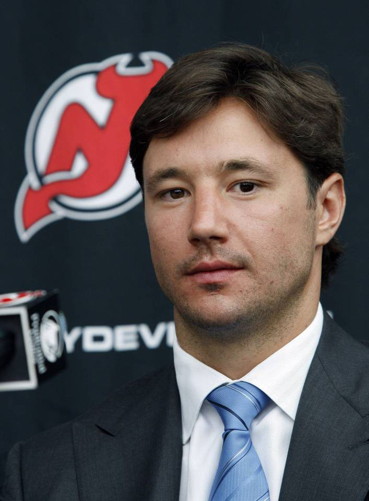 New Jersey Devils star forward Ilya Kovalchuk, of Russia, listens to a reporters question during a news conference in Newark, N.J., Tuesday, July 20, 2010. Kovalchuk is staying with the Devils after agreeing to a staggering 17-year, $102 million deal with the team.