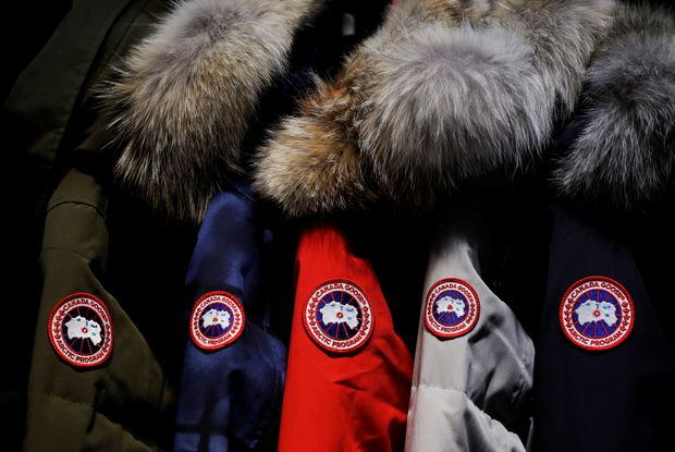 Jackets hang in the showroom of the Canada Goose factory in Toronto on Feb. 23, 2018.