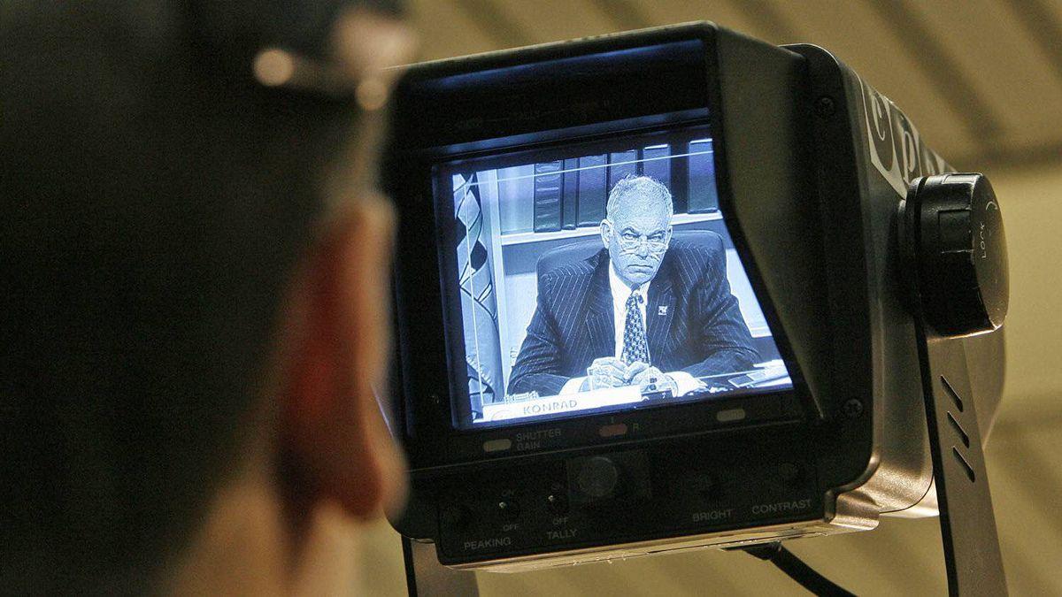 CRTC chairman Konrad von Finckenstein is seen through a camera monitor during a hearing in Gatineau, Que. on April 8, 2008.
