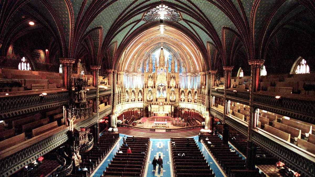 Tourists walk through the Notre-Dame Basilica in Montreal.