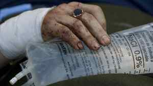The bloodied hand of a Canadian man who was found in the rubble of the Montana Hotel. He was evacuated with two other injured Canadians saved from the destroyed hotel.