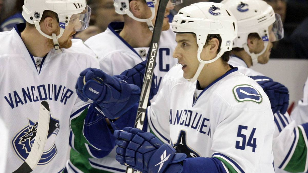 Vancouver Canucks' Aaron Volpatti (54) is congratulated by teammates after scoring during the second period of an NHL hockey game against the St. Louis Blues Monday, Dec. 20, 2010, in St. Louis. The Canucks won 3-1.