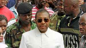 Liberian presidential candidate and warlord Charles Taylor arrives at a polling station during presidential voting in Monrovia, Liberia, in 1997.
