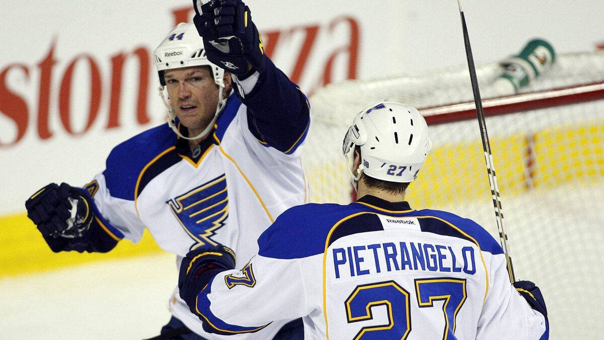 The St. Louis Blues' Jason Arnott, left, celebrates his second goal with teammate Alex Pietrangelo in Calgary, Feb. 27, 2012.
