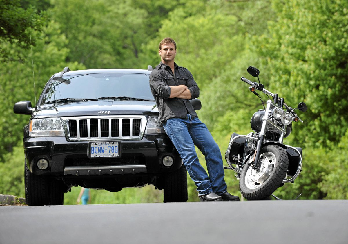 Dave Salmoni, adventurer, zoologist, animal trainer and a television host with his Jeep Grand Cherokee and his Harley Fat Bob.