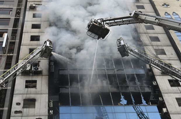 Fire in Bangladesh high-rise office building brought under control after 19 die