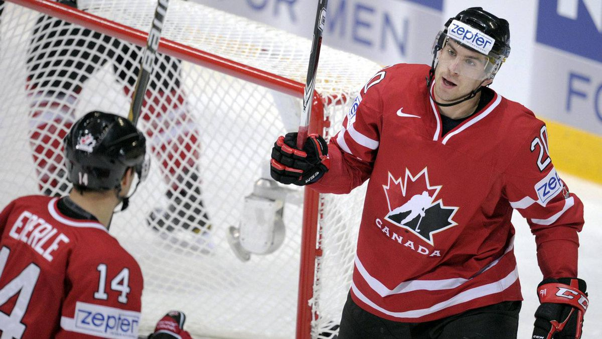 Canada's Jordan Eberle (L) and John Tavares celebrate the team's first goal during their Group H game Canada vs Switzerland of the 2012 IIHF World Championships in Helsinki, Finland, Wednesday May 9, 2012.