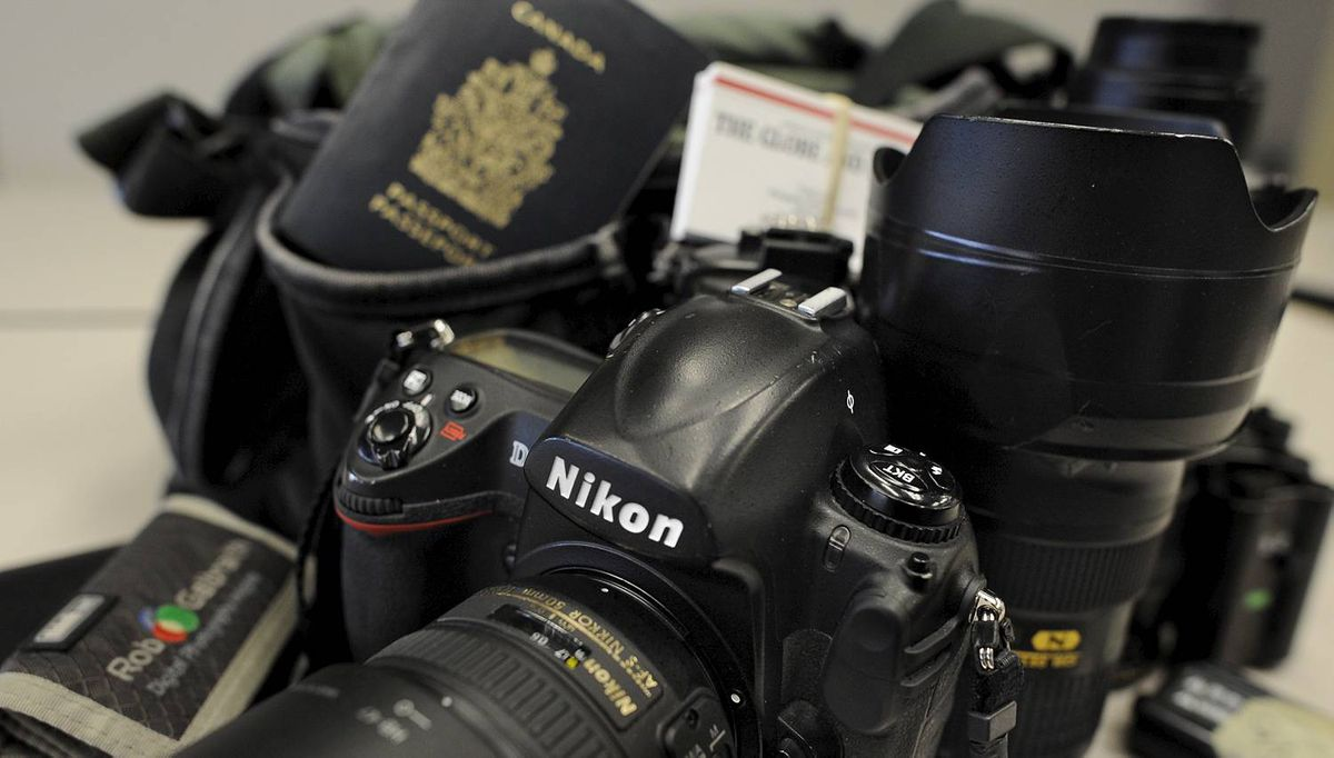 Photos of the camera and gear bags I use day to day in my job as a photographer for the Globe and Mail. A Domke F2 ballistic nylon bag that carries my digital gear. A Nikon D3, 50 1.4, 85 1.4, 24-70, 70-200, a Think Tank pixel pocket with bunch of 4gb cf cards, a Nikon SB800 flash, 5 or 6 batteries for the camera, some meds, pens, leather notebook and an up to date passport. (Fred Lum/The Globe and Mail) DIGITAL IMAGE