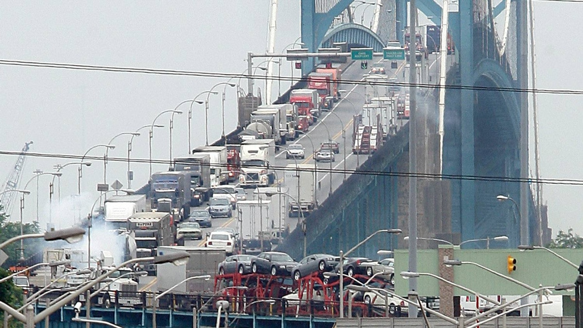 Traffic backs up on the Canadian side Ambassador bridge between Windsor, Ont., and Detroit in this 2006 file photo.