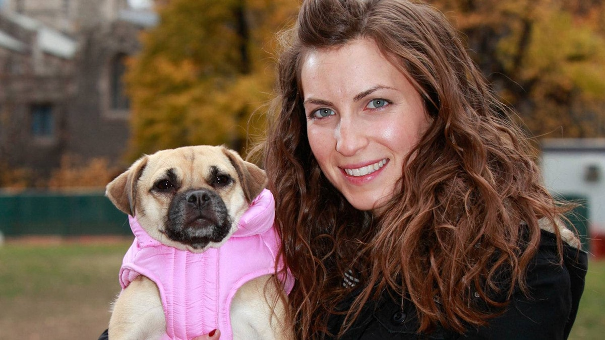 Canada Pooch founder and president Jacqueline Prehogan, right, and her pet puggle Bella