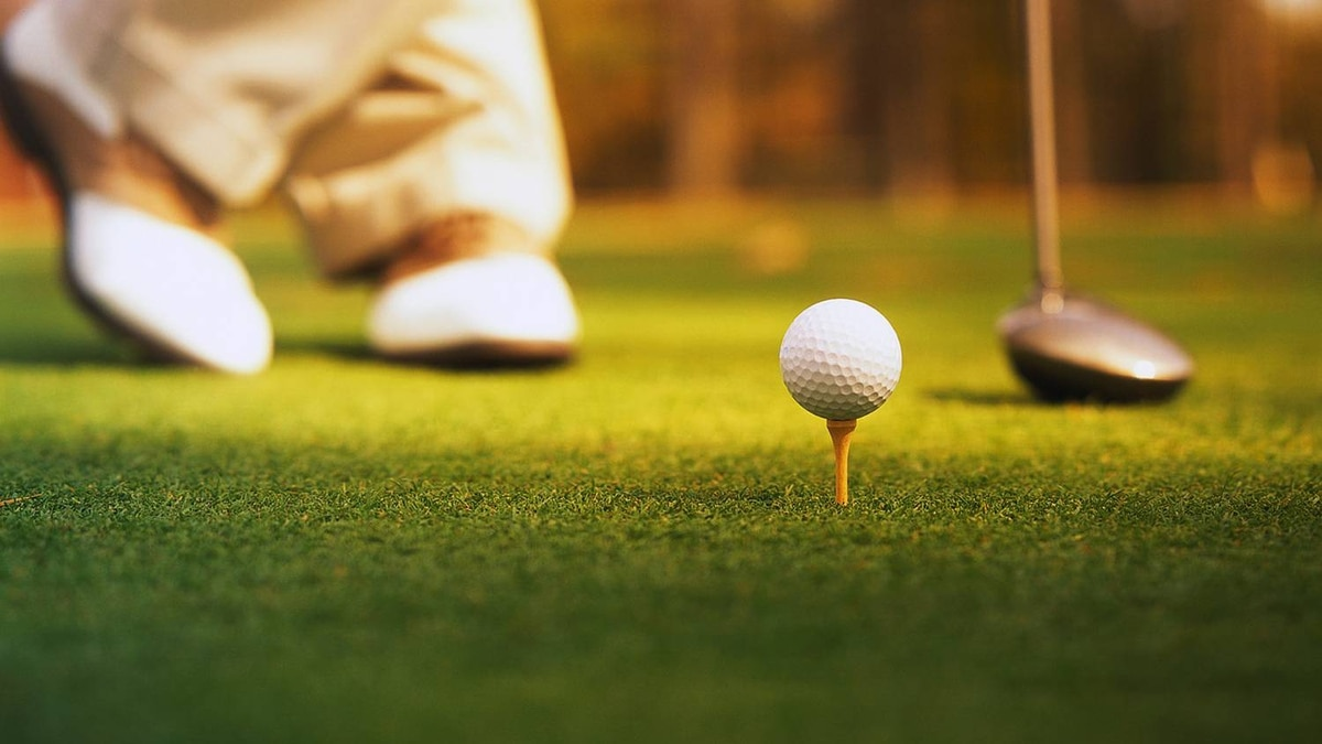 Golfer waiting to tee off