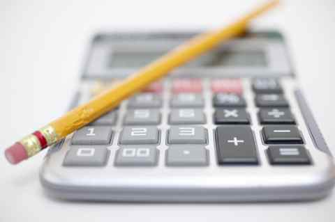A calculator with a chewed pencil.