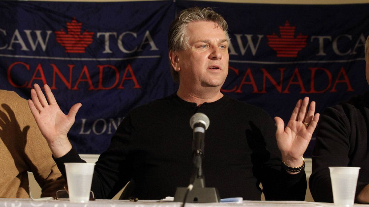 Canadian Auto Workers Union president Ken Lewenza spoke to the media after Electro-Motive Canada employees voted, agreeing to take a severance package negotiated by the CAW and the company in London, Feb. 23, 2012.