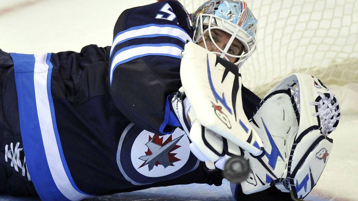 Winnipeg Jets' goaltender Chris Mason makes a save against the Carolina Hurricanes during the third period of their NHL game in Winnipeg October 22, 2011. The Jets won 5-3. REUTERS/Fred Greenslade