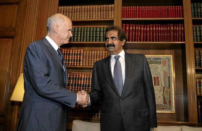Greece's Prime Minister George Papandreou (L) shakes hands with Qatar's Emir Sheikh Hamad bin Khalifa Al-Thani in Athens Oct. 1, 2011. Qatar Holdings will invest a total of $1-billion in European Goldfields, including $600 million to finance operations in Greece, where the firm has a permit to mine gold, the chief executive of the sovereign wealth fund said on Saturday.