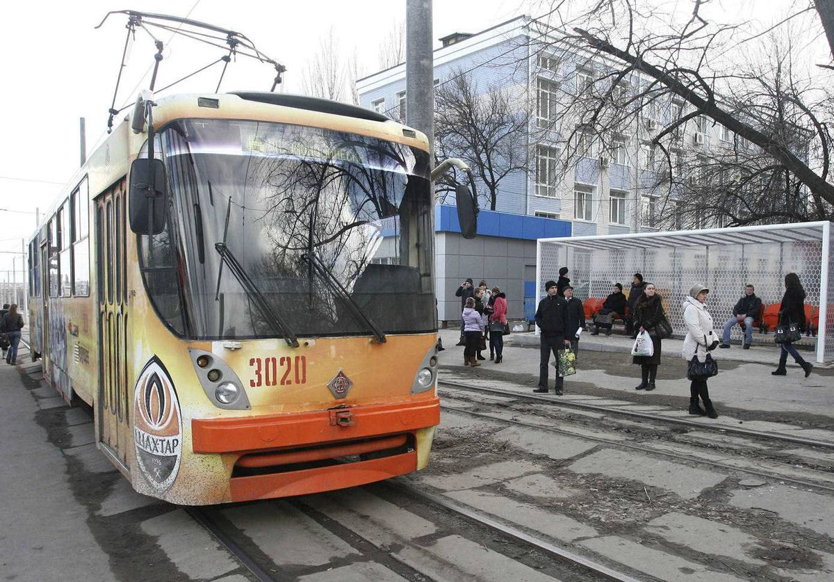 People stand at a public tram stop, designed to look like a goalpost, as part of preparations for the Euro 2012 soccer championship in Donetsk. Donetsk is one of four Ukrainian cities, which will host matches of the Euro 2012 soccer championship from June 8 to July 1.