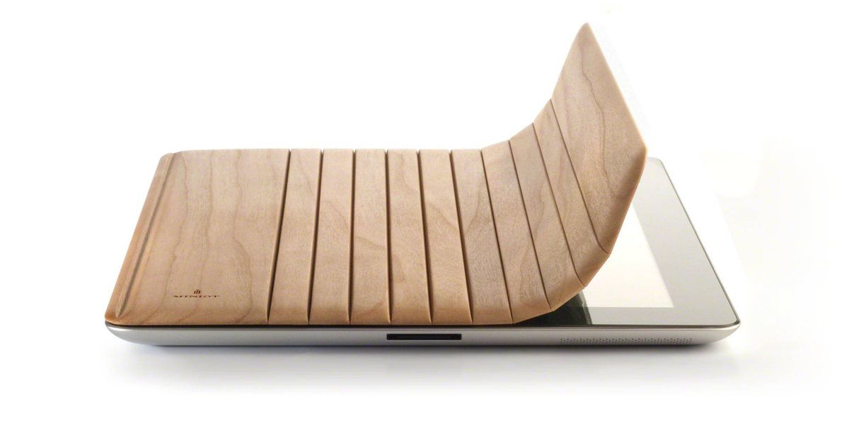 Why woodn't you? Give your iPad 2 a natural look with the new wooden Miniot cover. Carved in the Netherlands from a single piece of cherry, walnut, oak, maple or padouk (all sourced from sustainable forests), the cover has thin grooves that allow it to roll back into an adjustable stand that's perfect for movie viewing, picture taking and game playing. Every Miniot cover is custom-made and can be engraved. From $70 (50 euros), miniot.com