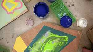 Pieces of art and open paint cans are seen on the floor as work continues on the Union Gospel Mission project created by students at Emily Carr University of Art and Design in Vancouver, Monday, April 02, 2012.