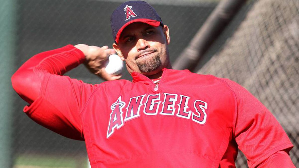 Los Angeles Angels' Albert Pujols warms up during a baseball spring training workout in Tempe, Arizona February 21, 2012.