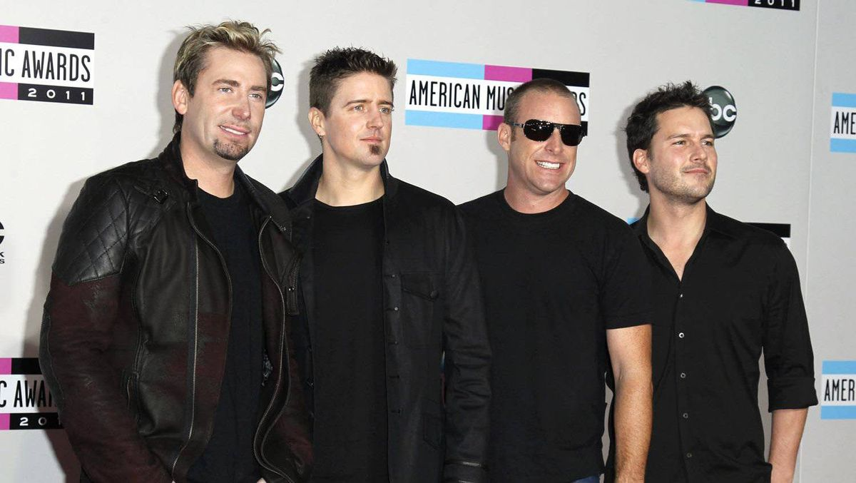 Rock band Nickelback poses on arrival at the 2011 American Music Awards in Los Angeles November 20, 2011.