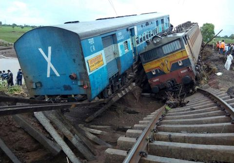 At least 24 killed, 300 rescued after trains derail on rain-flooded tracks in India