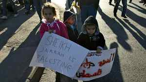 Palestinian children hold anti-Israeli occupation slogans during a weekly demonstration in the mostly Arab Jerusalem neighborhood of Sheikh Jarrah on January 21, 2011 .
